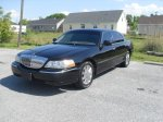 Lincoln Town Car Transports Three